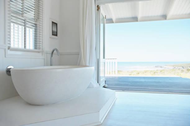Beautiful white bath tub in a modern apartment